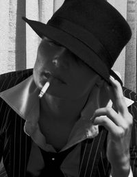 Woman with hat and cigarette