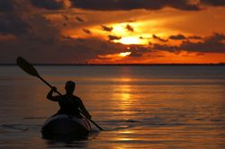 Kayak sunset woman ocean cdwheatley