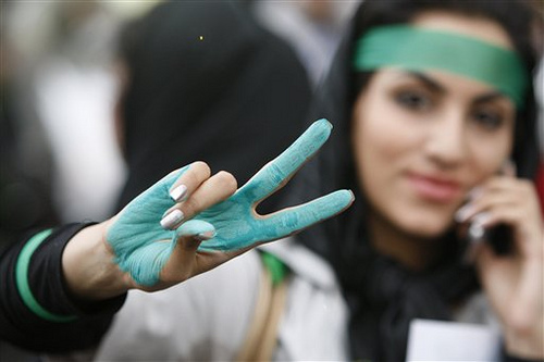 Iranian woman protesting green fingers