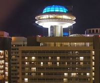 Atlanta Hyatt Regency rooftop restaurant flying saucer night John Portman architect